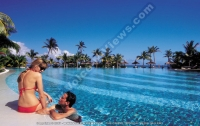 dinarobin_hotel_mauritius_couple_and_swimming_pool_view.jpg