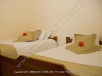 twin_bedroom_of_le_palmiste_resort_and_spa.jpg