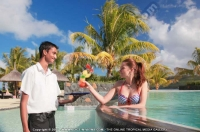 laguna_beach_hotel_and_spa_mauritius_guest_having_cocktail_in_the_swimming_pool.jpg