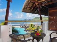 laguna_beach_hotel_and_spa_mauritius_room_balcony_with_swimming_pool_and_sea_view.jpg