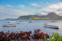 laguna_beach_hotel_and_spa_mauritius_sea_mountain_and_pirogue.jpg