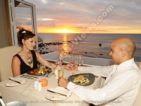 le_recif_hotel_mauritius_hotel_couple_having_diner_at_the_main_restaurant_with_sunset_view.jpg