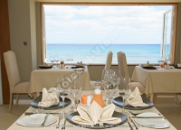 le_recif_hotel_mauritius_restaurant_interior_and_sea_view.jpg