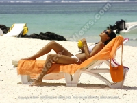 lady_having_her_sun_bath_on_the_beach_la_palmeraie_mauritius.jpg