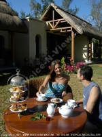 movenpick_resort_and_spa_hotel_mauritius_couple_having_tea_in_the_garden.jpg