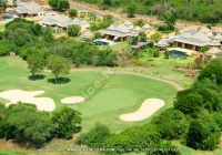 tamarina_golf_spa_and_beach_club_mauritius_green_and_villas_aerial_view.jpg