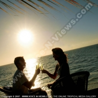 pearle_beach_hotel_mauritius_couple_having_champagne_at_sunset.jpg
