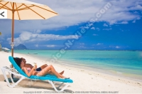pearle_beach_hotel_mauritius_couple_relaxing_in_sunbed.jpg