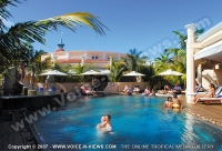 le_mauricia_hotel_mauritius_guests_relaxing_in_sunbed_and_at_the_pool.jpg