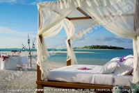 kanuhura_resort_maldives_bed_on_beach.jpg