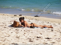 woman_bikini_lying_beach_le_morne_mauritius.jpg