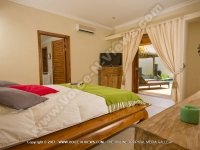 premium_villa_grand_bay_ref_16_bedroom_and_terrace_view.jpg