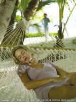 sainte_anne_resort_seychelles_lady_relaxing_in_hammock.jpg