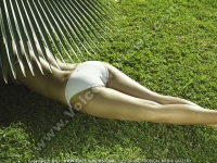 sainte_anne_resort_seychelles_sexy_lady_lying_on_the_grass.jpg