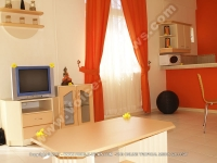 standard_apartment_pereyebere_ref_187_view_of_the_kitchen_side_and_the_tv_room.JPG