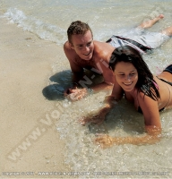 pearle_beach_hotel_mauritius_young_couple_smiling_and_lying_on_the_beach.jpg